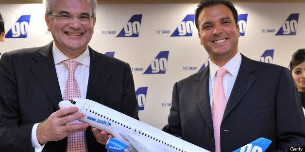 Indian budget carrier 'GoAir' CEO Giorgio Di Roni (L) and managing director Jeh Wadia pose with a model of an aircraft during a press conference in Mumbai on June 16, 2011.  Wadia said his company has placed an order for 72 new A320 Airbus aircraft in a deal worth up to 6.1 billion dollars at list prices.  The booming Indian market has become a key source of business for France-based Airbus, which won its biggest ever order in January from GoAir's local competitor IndiGo, who ordered 180 A320s, worth 15.6 billion dollars at list prices.   AFP PHOTO/ Indranil MUKHERJEE (Photo credit should read INDRANIL MUKHERJEE/AFP/Getty Images)