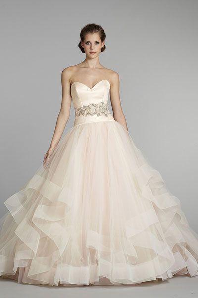"The big ruffles on this blush dress are so feminine and fun.  <a href=""http://lover.ly/explore?q=ruffled+wedding+dress&ut"