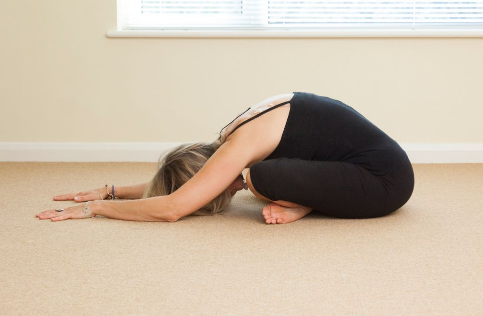 The easy forward bend pose is accessible even to beginners, and it's a great one to try before bedtime. If you're tight in th
