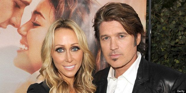 LOS ANGELES, CA - MARCH 25:  Executive producer Tish Cyrus (L) and actor Billy Ray Cyrus arrive at the premiere of Touchstone Picture's 'The Last Song' held at ArcLight Hollywood on March 25, 2010 in Los Angeles, California.  (Photo by Kevin Winter/Getty Images)