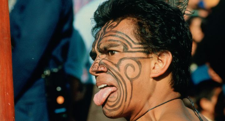 A Maori warrior in New Zealand gives a traditional challenge.