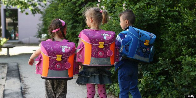 BERLIN, GERMANY - JUNE 05:  Kids from kindergarten 'Schneckenhaus' walk along a path with their new satchels on June 5, 2013 in Berlin, Germany.  (Photo by Andreas Rentz/Getty Images)