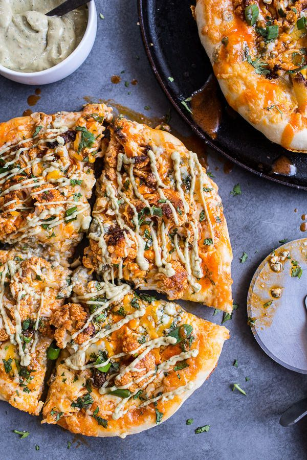"""<strong>Get the <a href=""""http://www.halfbakedharvest.com/buffalo-roasted-cauliflower-pizza-with-chipotle-blue-cheese-avocado-"""