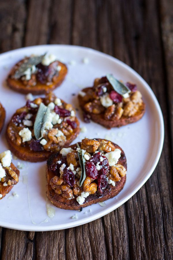 """<strong>Get the <a href=""""http://www.halfbakedharvest.com/curried-sweet-potato-rounds-honeyed-walnuts-cranberries-blue-cheese/"""