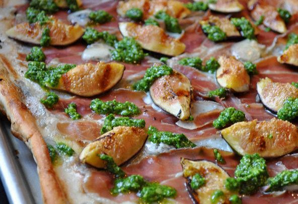"""<strong>Get the <a href=""""http://food52.com/recipes/994-grilled-pizza-with-figs-prosciutto-gorgonzola-and-arugula-pesto"""" targe"""