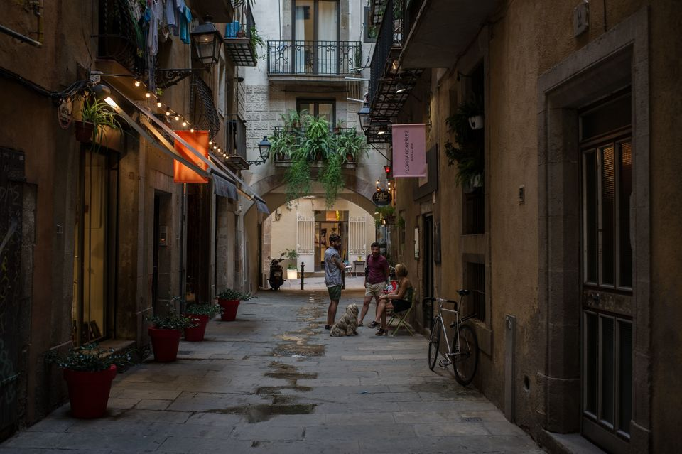 A group of people chat in a passage in Barcelona, Spain. (Photo by David Ramos/Getty Images)