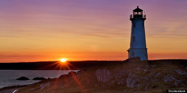 lighthouse during sunrise in...