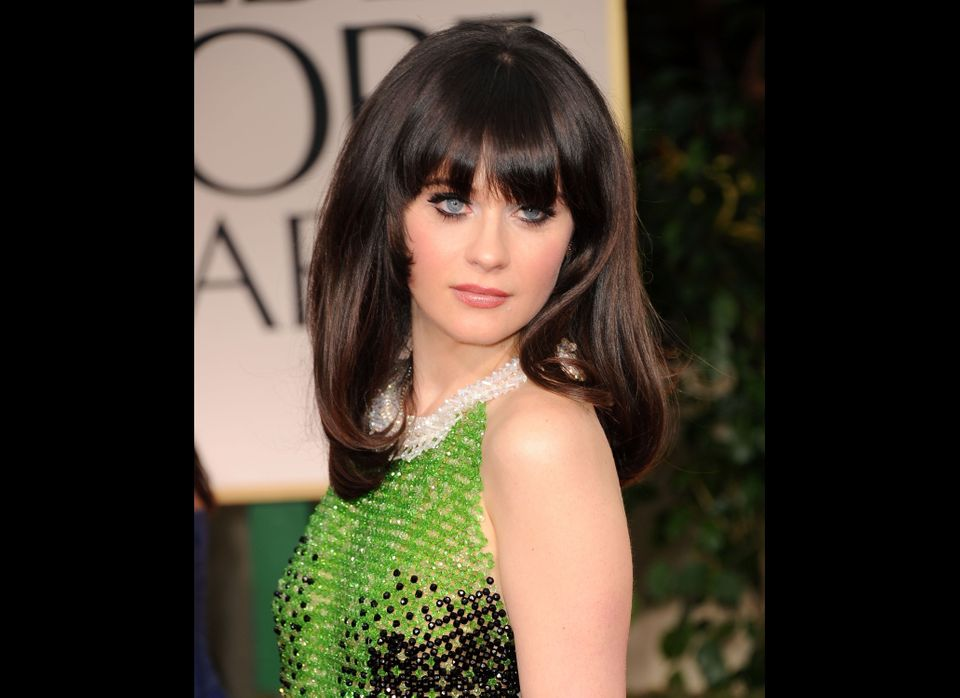 BEVERLY HILLS, CA - JANUARY 15:  Actress Zooey Deschanel arrives at the 69th Annual Golden Globe Awards held at the Beverly H