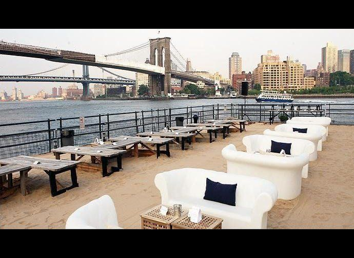 """Located at the former Water Taxi Beach in South Street Seaport, <a href=""""http://www.beekmanbeergarden.com/"""" target=""""_hplink"""">"""