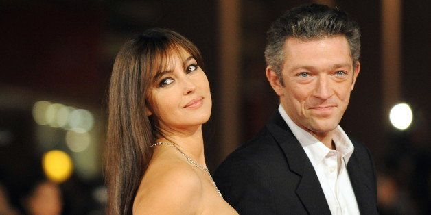Italian actress Monica Bellucci (L) and her husband, French actor Vincent Cassel  arrive for the screening of 'L'uomo che ama' (The man who loves) on October 23, 2008 at the Rome International film festival. 'Luomo che ama' by Maria Sole Tognazzi, starring Pierfrancesco Favino, Monica Bellucci and Ksenia Rappoport is competiting in the official selection of the festival. AFP PHOTO / ALBERTO PIZZOLI        (Photo credit should read ALBERTO PIZZOLI/AFP/Getty Images)