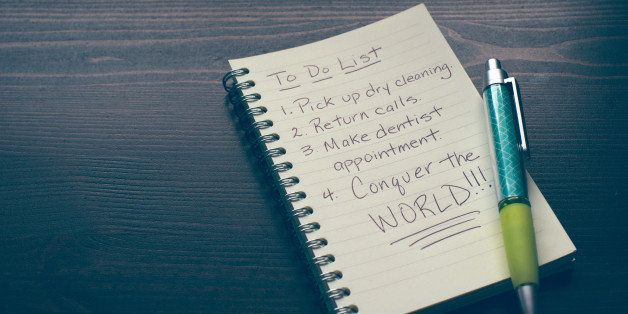 A pen and notebook with a humorous to do list.