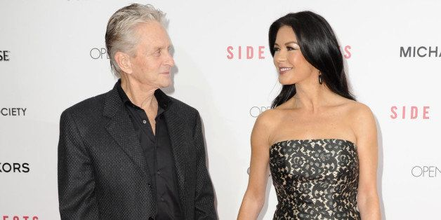 NEW YORK, NY - JANUARY 31:  Michael Douglas and Catherine Zeta-Jones attend the premiere of 'Side Effects' hosted by Open Road with The Cinema Society and Michael Kors at AMC Lincoln Square Theater on January 31, 2013 in New York City.  (Photo by Dave Kotinsky/Getty Images)
