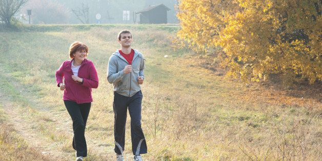 mom and son jogging in a meadow