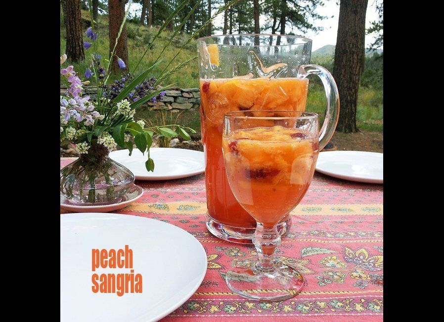 "It's beautiful. It's sweet. It's fruity. And you will want to drink more than one glass. Peach Sangria by <a href=""http://www"