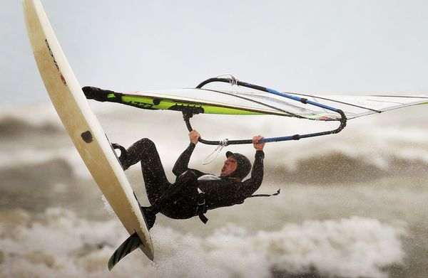 Juan Piantino wind surfs along Montrose Beach October 19, 2011 in Chicago. Photo by Scott Olson/Getty Images.