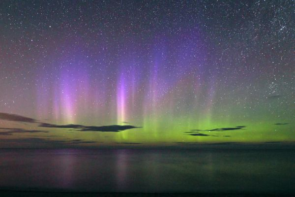 A view displaying the Northern Lights affected by the solar tsunami over Lake Superior on Aug. 4, 2010 in Marquette, Michigan