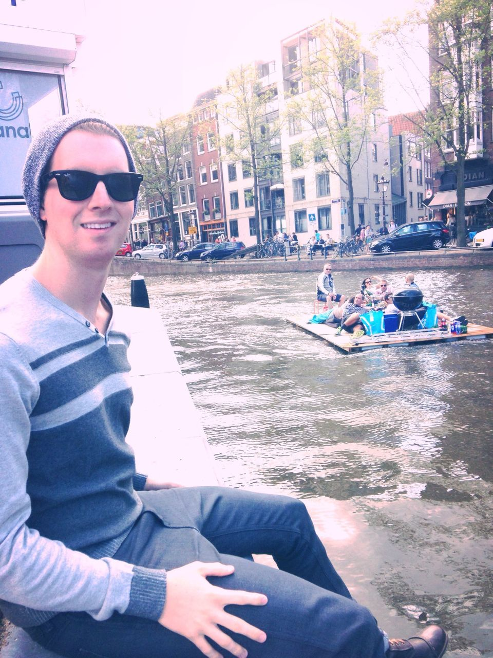 """""""On the canal. Like this picture because you can see the canal, awesome houses and the people on the floating raft behind me."""