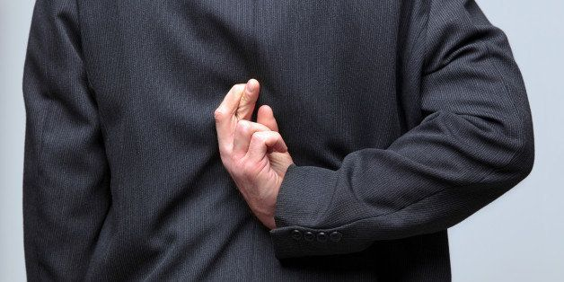 businessman with his fingers...