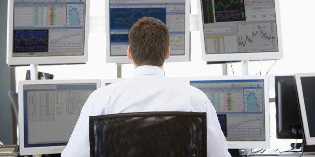 stock trader looking at...