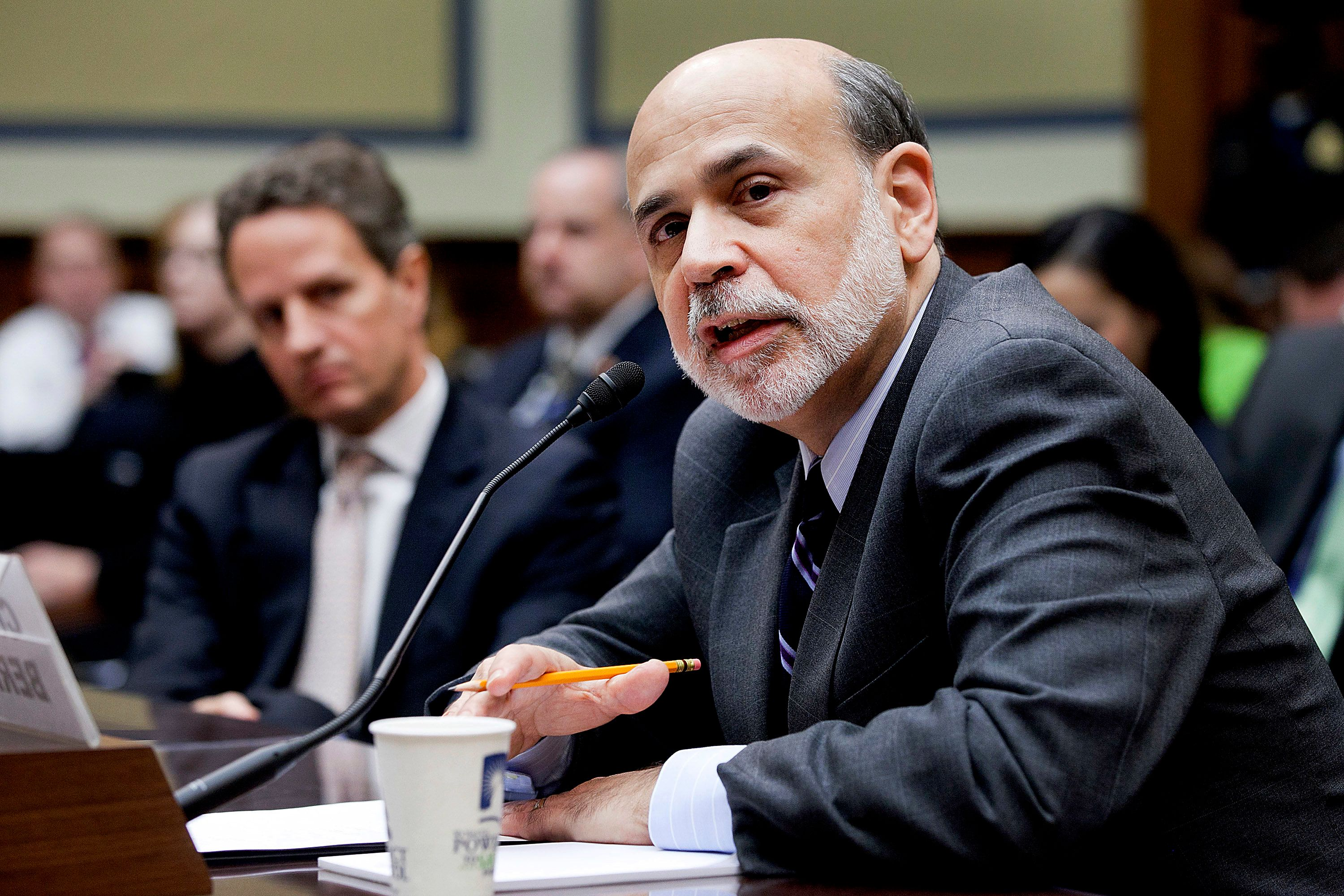 "Ben Bernanke (right) and Timothy Geithner (background) say they did what they had to do to ""prevent the collapse of the"