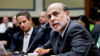 Ben S. Bernanke, chairman of the U.S. Federal Reserve, right, speaks during a House Oversight and Government Reform Committee hearing with Timothy F. Geithner, U.S. treasury secretary, in Washington, D.C., U.S., on Wednesday, March 21, 2012. Bernanke said Europe must further strengthen its banks and that its financial and economic situation 'remains difficult' even as stresses have lessened, according to testimony prepared for delivery to U.S. lawmakers today. Photographer: Andrew Harrer/Bloomberg via Getty Images