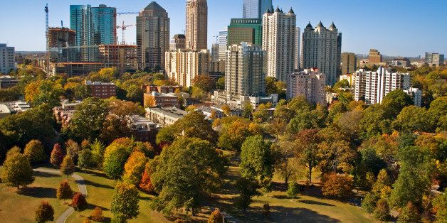 Atlanta skyscrapers as seen by a camera lofted by kite over Piedmont Park.In the foreground, park grass suffers from a drough