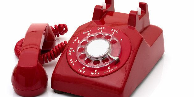a red retro telephone isolated...