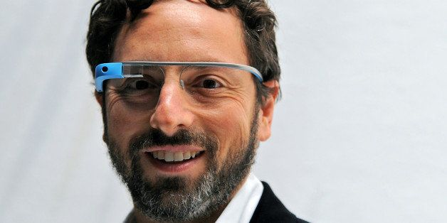 Sergey Brin, co-founder of Google Inc., stands for a photograph while wearing Project Glass internet glasses at the Diane Von Furstenberg fashion show in New York, U.S., on Sunday, Sept. 9, 2012. Google Inc., owner of the world?s most popular search engine, will sell eyeglass-embedded computers to consumers by 2014 after incorporating feedback from developers, said Brin. Photographer: Peter Foley/Bloomberg via Getty Images
