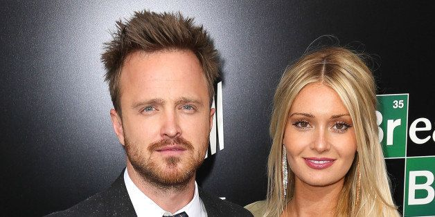 CULVER CITY, CA - JULY 24:  Actor Aaron Paul (L) and his wife, Lauren Parsekian, arrive as AMC Celebrates the final episodes of 'Breaking Bad' at Sony Pictures Studios on July 24, 2013 in Culver City, California.  (Photo by Imeh Akpanudosen/Getty Images)