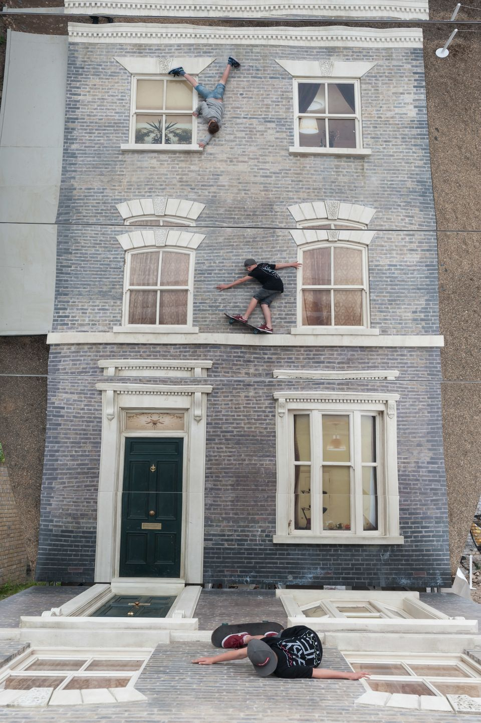 "Visitors play with illusion Leandro Erlich: Dalston House Installation images © Gar Powell-Evans 2013 Courtesy of <a href=""ht"