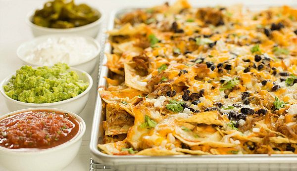 """<strong>Get the <a href=""""http://www.browneyedbaker.com/2013/09/17/ultimate-nachos-with-beer-braised-carnitas/"""" target=""""_blank"""