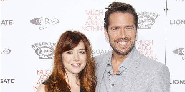 HOLLYWOOD, CA - JUNE 05:  Alyson Hannigan and Alexis Denisof arrive at the Los Angeles screening of 'Much Ado About Nothing' held at Oscars Outdoors on June 5, 2013 in Hollywood, California.  (Photo by Michael Tran/FilmMagic)