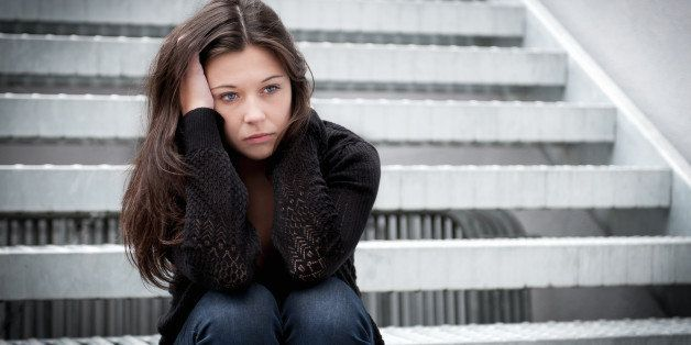 outdoor portrait of a sad...