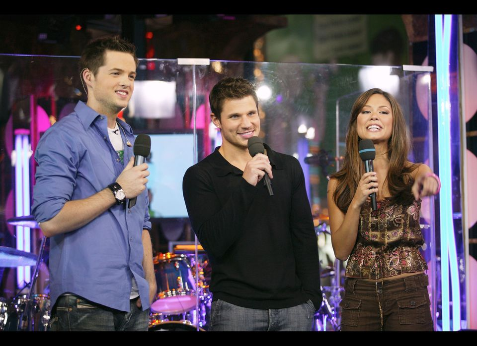 Nick Lachey appears on stage with VJ's Vanessa Minnillo and Damien Fahey during 'Spankin' New Music Week' on MTV's Total Requ