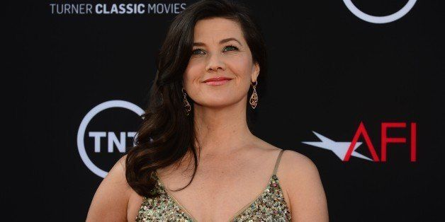 Daphne Zuniga poses on arrival for the American Film Institutes 41st Life Achievement Award Gala Tribute at the Dolby Theater in Hollywood, California, on June 6, 2013, where Mel Brooks was presented with the award, considered America's highest honour for a career in film.  AFP PHOTO/Federic J. BROWN        (Photo credit should read FREDERIC J. BROWN/AFP/Getty Images)
