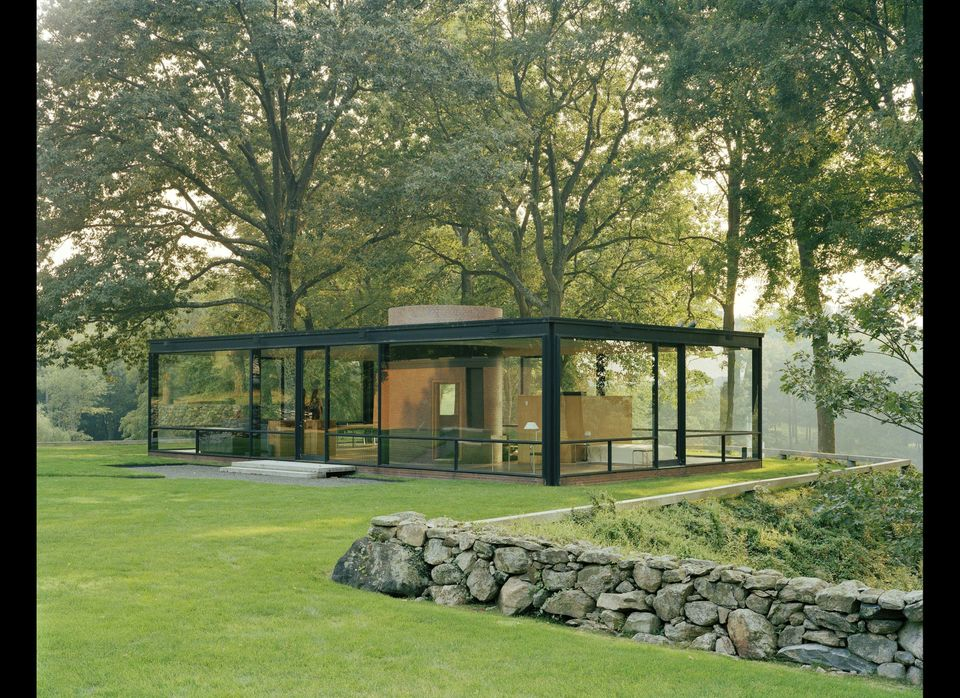 The main pavilion of The Glass House sits on a promontory overlooking a pond with views towards the woods beyond. Each of the