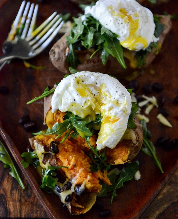 "<strong>Get the <a href=""http://www.howsweeteats.com/2013/05/cheesy-black-bean-stuffed-sweet-potatoes-with-arugula-poached-eg"