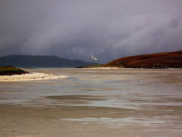 "This plane is landing on a beach. For real. The t<a href=""http://www.scotland.org/features/barra-airport"" target=""_blank"">hre"