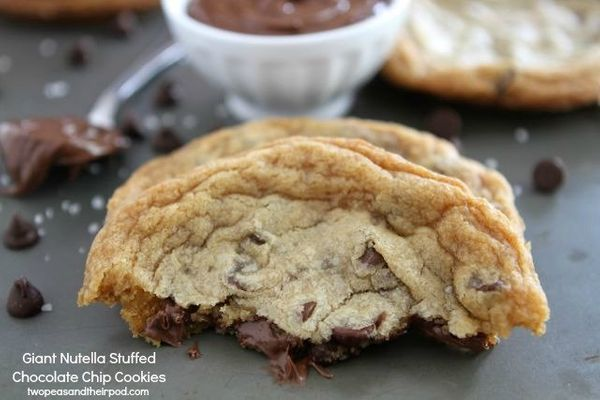 """<strong>Get the <a href=""""http://www.twopeasandtheirpod.com/giant-nutella-stuffed-chocolate-chip-cookies/"""" target=""""_blank"""">Gia"""