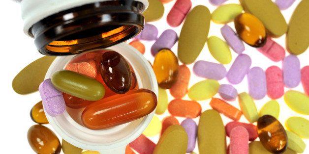 pills an pill bottle on white...