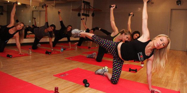 NEW YORK, NY - SEPTEMBER 20:  Celebrity fitness expert Tracy Anderson trains with POM Coconut and invited guests during a private workout at Le Parker Meridien on September 20, 2013 in New York City.  (Photo by Donald Bowers/Getty Images for POM)