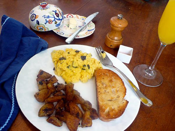 """<strong>Get the <a href=""""http://food52.com/recipes/15084-eggs-with-black-truffles-brouillade-de-truffes"""" target=""""_blank"""">Eggs"""