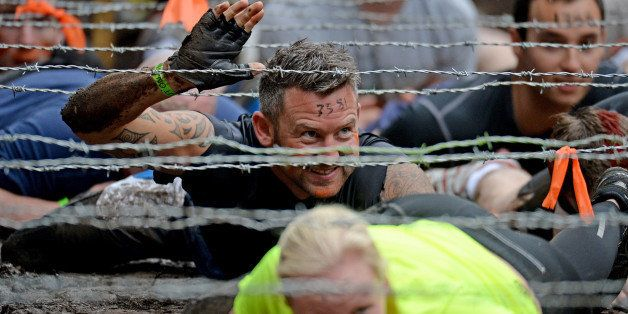 EDINBURGH, SCOTLAND - AUGUST 24:  Participents take part in the Tough Mudder endurance event at Dalkieth Country Estate on August 24, 2013 in Edinburgh, Scotland. The world-famous Tough Mudder is military style endurance event over 10-12 miles with various obstacles around the course designed by Briish Special Forces.  (Photo by Jeff J Mitchell/Getty Images)