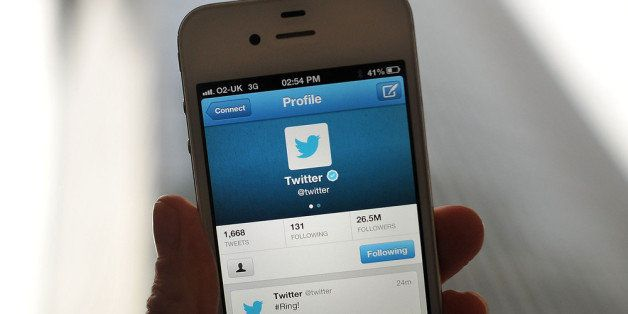 LONDON, ENGLAND - NOVEMBER 07:  In this photo illustration, the Twitter logo and hashtag '#Ring!' is displayed on a mobile device as the company announced its initial public offering and debut on the New York Stock Exchange on November 7, 2013 in London, England. Twitter went public on the NYSE opening at USD 26 per share, valuing the company's worth at an estimated USD 18 billion.  (Photo by Bethany Clarke/Getty Images)