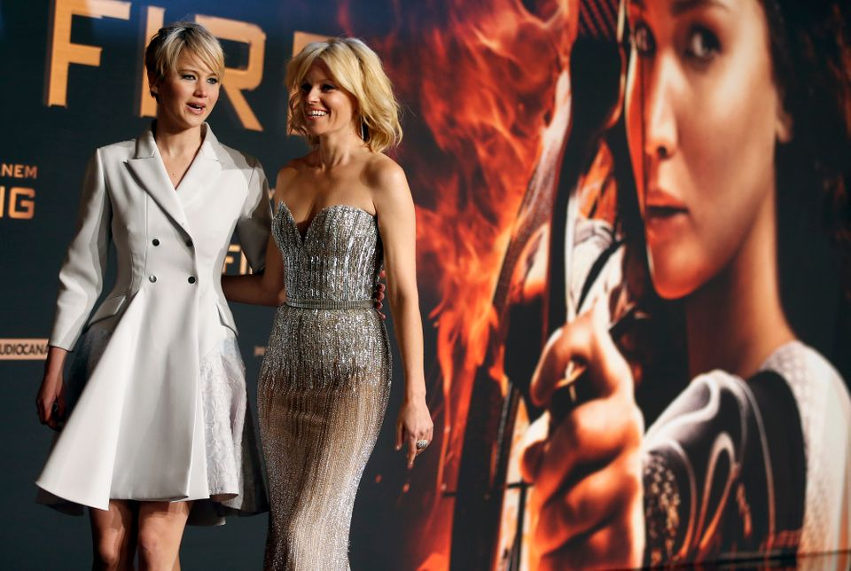 Actresses Elizabeth Banks, right, and Jennifer Lawrence, both from the US, pose for photographers as they arrive at the Germa