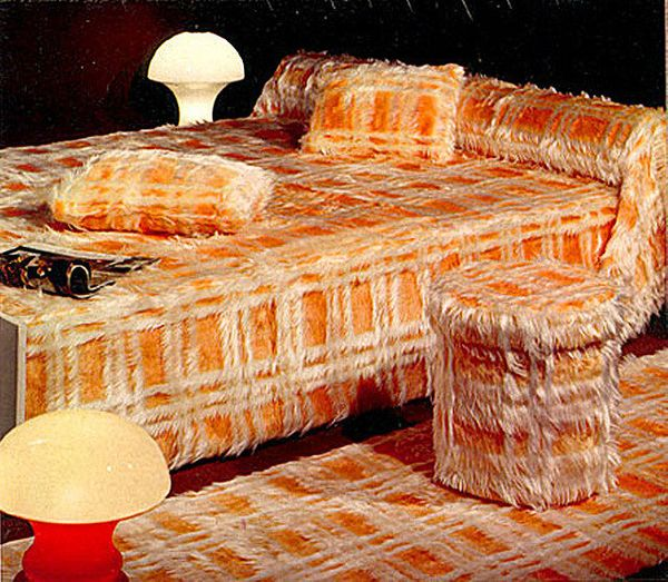 A shaggy, orange plaid sleigh bed, ottoman, pillows and carpet set. Need we say more?