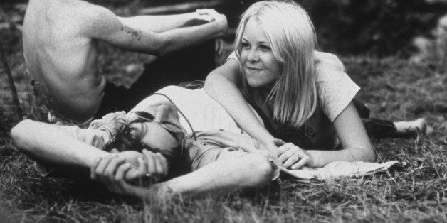 Young couple relaxing during Woodstock Music Festival.  (Photo by Bill Eppridge//Time Life Pictures/Getty Images)