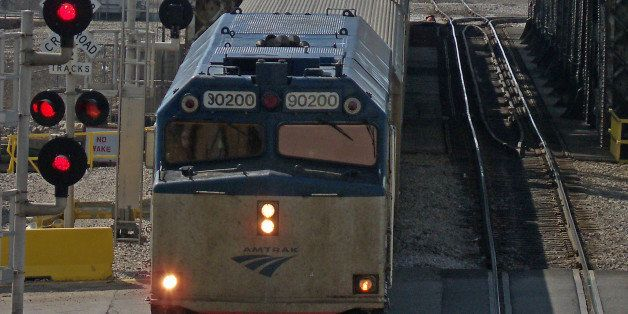 An Amtrak train heading to Union Station passes through the Canal Street Railroad Bridge