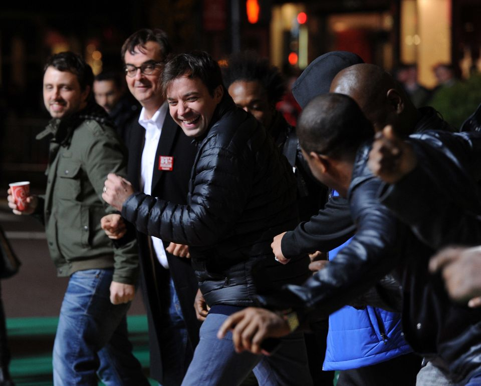 NEW YORK - NOVEMBER 23:  TV personality Jimmy Fallon(center) performs with The Roots at the 84th Annual Macy's Thanksgiving d
