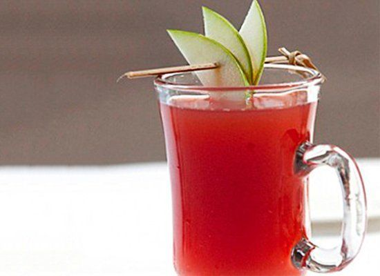 "Having a party? Whip up this spirited fall drink that features apple cider, pomegranate, <a href=""http://liquor.com/spirit/co"